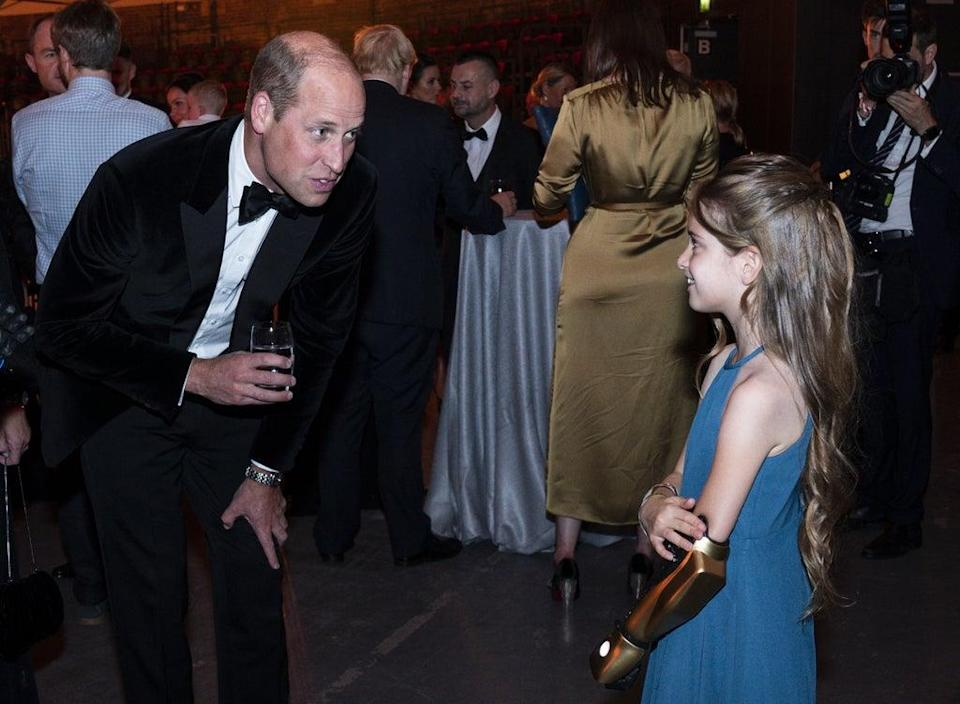 The Duke of Cambridge speaks with Phoebe Sinclair, who has a Disney themed robotic arm (Arthur Edwards/The Sun) (PA Wire)