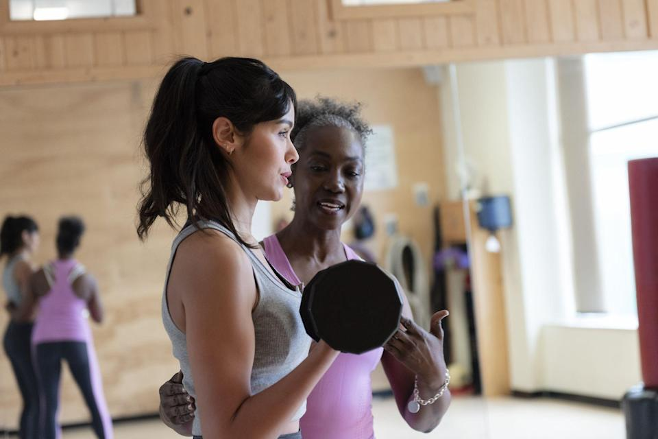 """<p>Want to take your fitness routine to the next level? Working out with a personal trainer can actually boost the success rate of achieving your fitness goals by more than 30 percent, according to a study by the <em>Journal of Sports Science & Medicine</em>. So whether you want to get in shape for the summer, beat the competition in a marathon, or just feel better...go for it! Hitting your goals can come a lot easier if you've got a coach on your side. </p><p>But before you can hit the ground running, make sure that you know what you're signing up for. Hiring a personal trainer can be pricy—the cost ranges from $15 to $100 per hour, according to the National Strength and Conditioning Association. And that may be in addition to a gym membership fee. """"This is an investment in your quality of life,"""" says Gunnar Peterson, the Head of Strength and Endurance Training for the Los Angeles Lakers and a <a href=""""http://gunnarpeterson.com/"""" rel=""""nofollow noopener"""" target=""""_blank"""" data-ylk=""""slk:celebrity fitness trainer"""" class=""""link rapid-noclick-resp"""">celebrity fitness trainer</a> based in Beverly Hills. """"Your gym experience improves everything you do outside of the workout itself."""" If you've decided to try working out with a trainer, not only will you work out smarter, hit your goals faster, but you may actually make a new friend, too.</p>"""