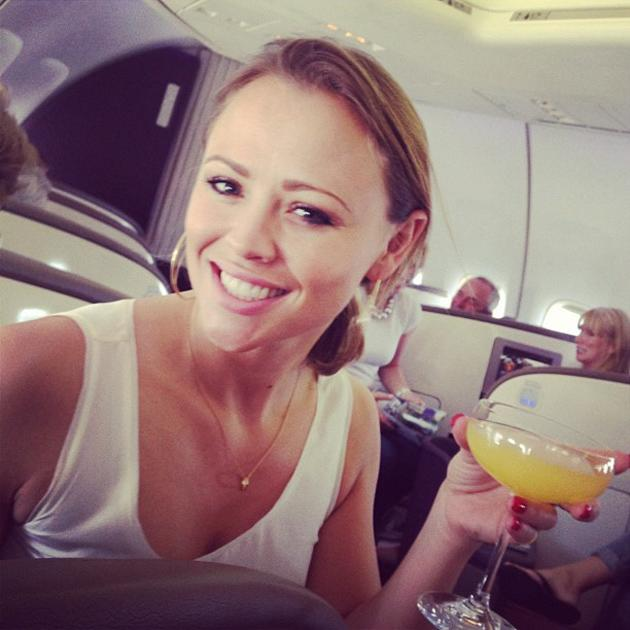 Celebrity photos: After her long stint in Shrek The Musical, Kimberley Walsh is now jetting off on holiday with her Girls Aloud bandmate Nicola Roberts. The pair are heading off to Las Vegas, and Nicola shared this photo of Kimberley sipping a cocktail on the plane. Well jel. Copyright [Nicola Roberts]