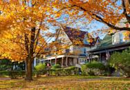 """<p>Seeing the homes in your neighborhood covered in a layer of foliage will fill you with instant nostalgia about sipping <a href=""""https://www.countryliving.com/food-drinks/g1028/cider-recipes/"""" rel=""""nofollow noopener"""" target=""""_blank"""" data-ylk=""""slk:apple cider"""" class=""""link rapid-noclick-resp"""">apple cider</a> and watching <a href=""""https://www.countryliving.com/life/entertainment/g21240020/fall-movies/"""" rel=""""nofollow noopener"""" target=""""_blank"""" data-ylk=""""slk:fall movies"""" class=""""link rapid-noclick-resp"""">fall movies </a>as a kid.</p>"""