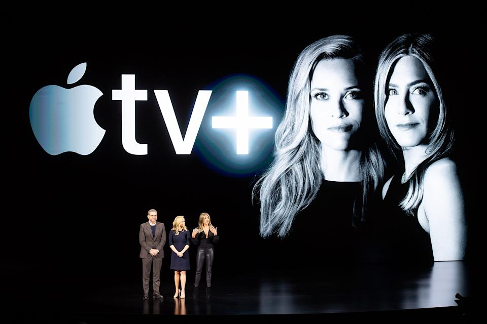 Actors Steve Carell, Reese Witherspoon and Jennifer Aniston speak during an event launching Apple tv+ at Apple headquarters on March 25, 2019, in Cupertino, California. (Photo by NOAH BERGER / AFP)        (Photo credit should read NOAH BERGER/AFP/Getty Images)