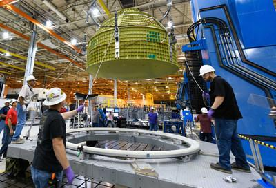 Lockheed Martin technicians are building at the NASA Michoud Assembly Hall in Louisiana completed the first Orion capsule structure that will carry humans on space exploration mission-2. Courtesy of NASA