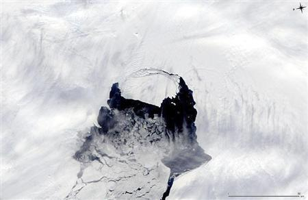 A NASA handout of an iceberg from the Pine Island Glacier separating from the Antarctica continent