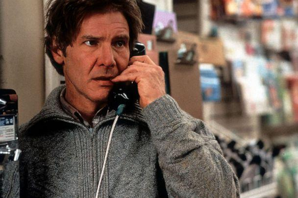 PHOTO: Harrison Ford talks on a pay phone in a scene from the 1993 film 'The Fugitive.' (Warner Brothers/Getty Images)