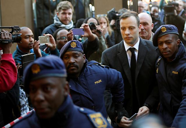 Olympic and Paralympic track star Oscar Pistorius is escorted by police officers as he arrives for his sentencing for the 2013 murder of his girlfriend Reeva Steenkamp, at North Gauteng High Court in Pretoria, South Africa July 6, 2016. REUTERS/Siphiwe Sibeko