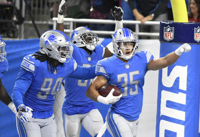 Celebrate: One Lions fan has turned season tickets surrendered by a fan into a gift intended for charities that serve Detroit-area children. (AP)