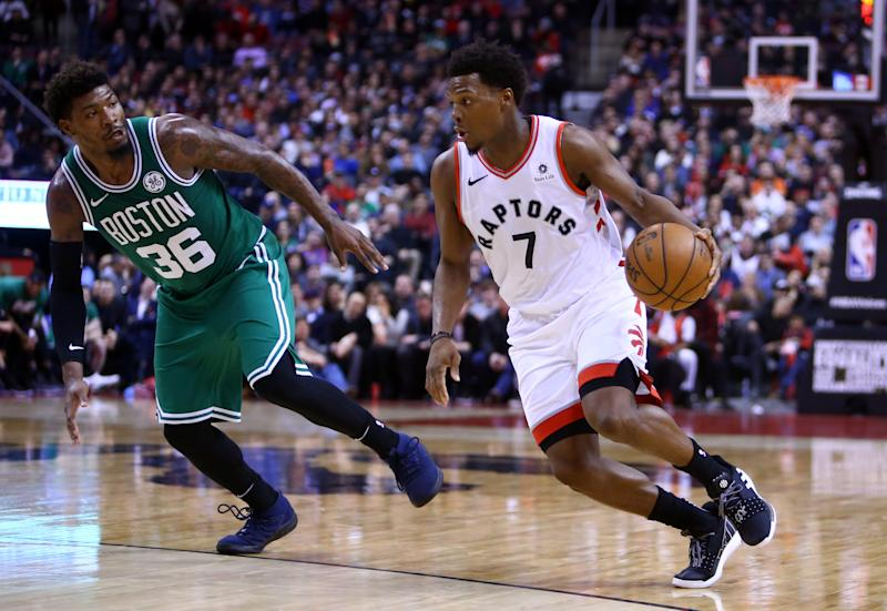 TORONTO, ON - FEBRUARY 26: Kyle Lowry #7 of the Toronto Raptors dribbles the ball as Marcus Smart #36 of the Boston Celtics defends during the second half of an NBA game at Scotiabank Arena on February 26, 2019 in Toronto, Canada. NOTE TO USER: User expressly acknowledges and agrees that, by downloading and or using this photograph, User is consenting to the terms and conditions of the Getty Images License Agreement. (Photo by Vaughn Ridley/Getty Images)