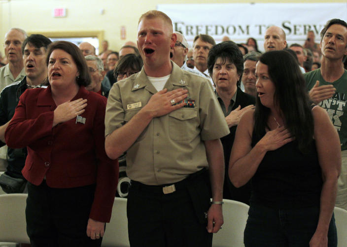 """U.S. First Class Petty officer Benjamin Jett (C) recites the pledge of allegiance along with members of San Diego's gay and lesbian community as they gather to celebrate the expiration of the U.S. military policy """"Don't Ask Don't Tell"""" at the San Diego LGBT community center September 20. 2011. The policy had allowed gay men and women to serve in the military only if they kept their sexual orientation a secret. They faced the threat of being kicked out of the military if they were open about their homosexuality. (Photo: REUTERS/Mike Blake)"""