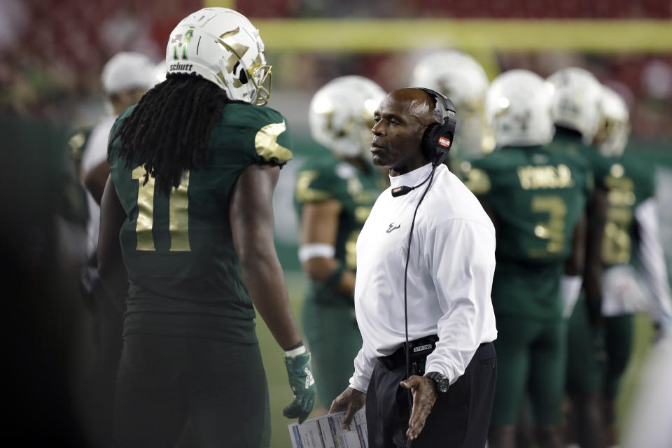 South Florida head coach Charlie Strong talks to linebacker Dwayne Boyles Jr., during the second half of an NCAA college football game against Memphis Saturday, Nov. 23, 2019, in Tampa, Fla. (AP Photo/Chris O'Meara)