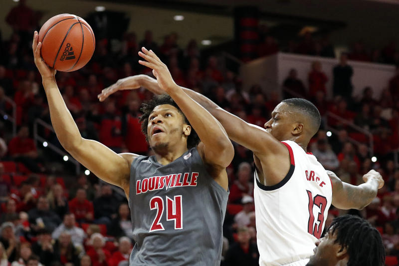 Louisville's Dwayne Sutton (24) drives the ball to the basket past North Carolina State's C.J. Bryce (13) during the second half of an NCAA college basketball game in Raleigh, N.C., Saturday, Feb. 1, 2020. (AP Photo/Karl B DeBlaker)