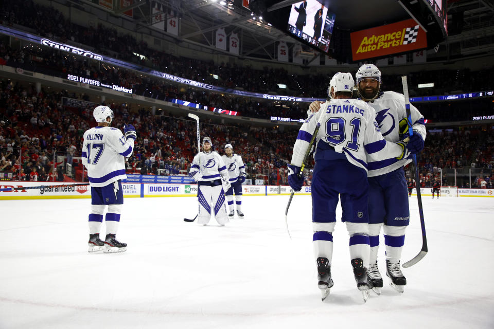 RALEIGH, NORTH CAROLINA - JUNE 08: Steven Stamkos #91 and Pat Maroon #14 of the Tampa Bay Lightning react after defeating the Carolina Hurricanes in Game Five of the Second Round of the 2021 Stanley Cup Playoffs at PNC Arena on June 08, 2021 in Raleigh, North Carolina. (Photo by Jared C. Tilton/Getty Images)
