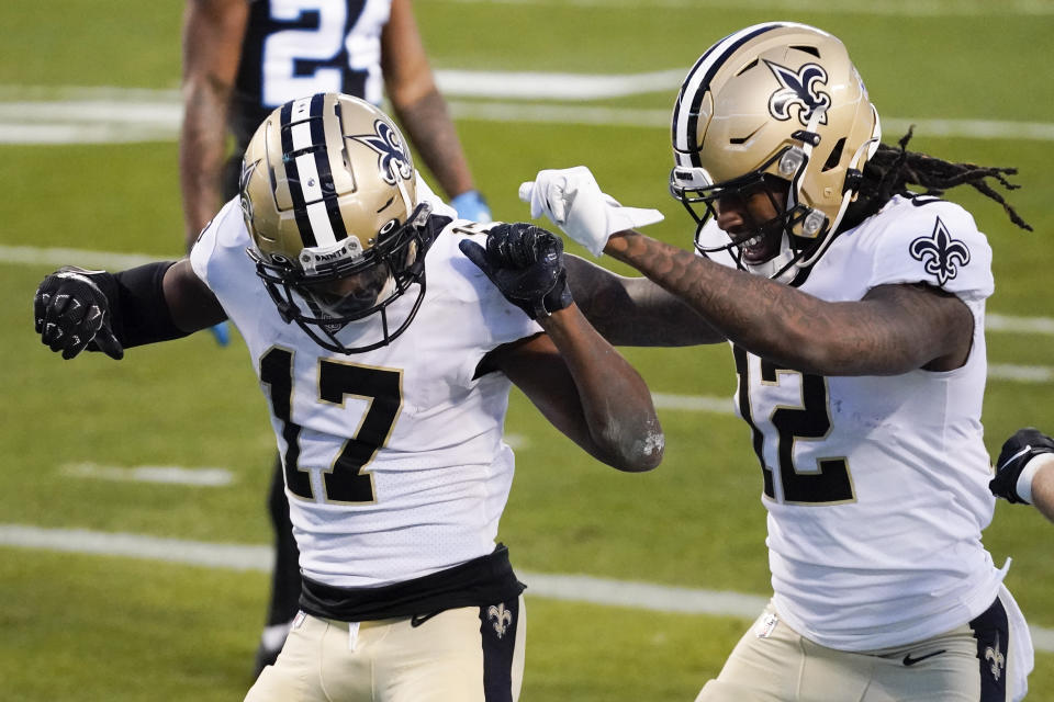 New Orleans Saints wide receiver Emmanuel Sanders celebrates after scoring with wide receiver Marquez Callaway during the first half of an NFL football game against the Carolina Panthers Sunday, Jan. 3, 2021, in Charlotte, N.C. (AP Photo/Gerry Broome)