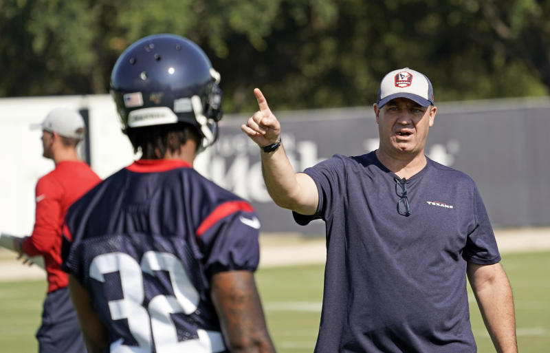 Houston Texans coach Bill O'Brien, right, talks to cornerback Lonnie Johnson Jr. (32) during an NFL football training camp practice Thursday, July 25, 2019, in Houston. (AP Photo/David J. Phillip)