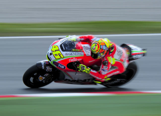 Ducati Team's Italian Valentino Rossi rides during a Moto GP training session at the Catalunya racetrack in Montmelo, near Barcelona, on June 4, 2012. AFP PHOTO / JOSEP LAGOJOSEP LAGO/AFP/GettyImages