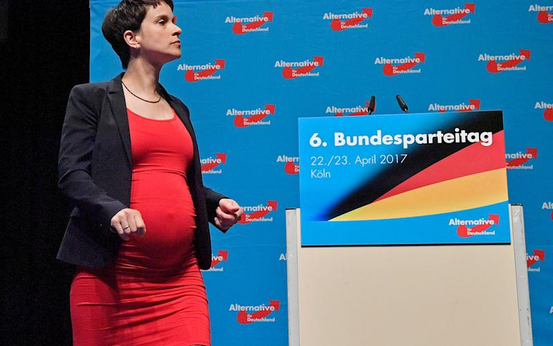 Co-leader Frauke Petry walks on the podium at the party convention - Credit: AP
