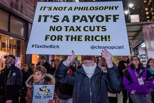 "<p>Over a hundred protesters met at Greeley Square in Midtown Manhattan on Nov. 27, 2017 and marched along 34th Street behind a ""Not One Penny of Tax Cuts for the Rich"" banner, with ""Tax Scam"" signs, ""Not One Penny"" signs and giant checks made out from Medicaid or Medicare to billionaires or corporations, to raise awareness against the irresponsible tax plan that cuts Medicare and increases healthcare costs for older New Yorkers. (Photo: Erik Mcgregor/Pacific Press via ZUMA Wire) </p>"