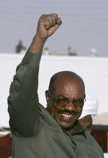 FILE -- In this Saturday, March 21, 2009 file photo, Sudanese President Omar el Bashir greets supporters in Toti, an island between Blue and White Nile rivers, in Khartoum, Sudan. Sudan is calling on the United States to issue its president a visa as soon as possible to attend the U.N. General Assembly which opened yesterday, Monday, Sept. 17, 2013. The U.S. State Department said Washington has received Sudan's visa request, but that before presenting himself to the U.N. headquarters, El-Bashir should present himself to the International Criminal Court to answer for crimes linked to the conflict in Darfur. (AP Photo/Abd Raouf, File)