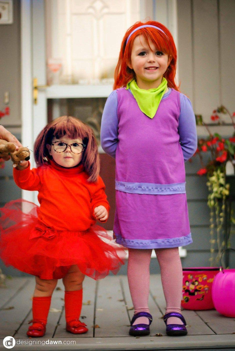 """<p>How sweet are these sisters as two members of the <a href=""""https://www.countryliving.com/diy-crafts/g22500148/70s-costumes/"""" rel=""""nofollow noopener"""" target=""""_blank"""" data-ylk=""""slk:'70s cartoon"""" class=""""link rapid-noclick-resp"""">'70s cartoon</a>?</p><p><strong>Get the tutorial at <a href=""""http://designingdawn.com/happy-halloween-diy-scooby-doo-gang-costumes/"""" rel=""""nofollow noopener"""" target=""""_blank"""" data-ylk=""""slk:Designing Dawn"""" class=""""link rapid-noclick-resp"""">Designing Dawn</a>.</strong></p><p><a class=""""link rapid-noclick-resp"""" href=""""https://www.amazon.com/Coxlures-Girls-Ballet-Tutu-Red/dp/B002GZPTTO?tag=syn-yahoo-20&ascsubtag=%5Bartid%7C10050.g.21530121%5Bsrc%7Cyahoo-us"""" rel=""""nofollow noopener"""" target=""""_blank"""" data-ylk=""""slk:SHOP RED TUTU"""">SHOP RED TUTU</a></p>"""