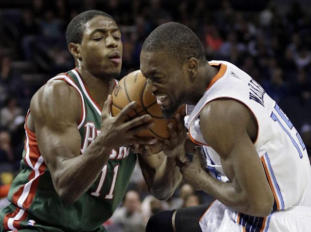 Milwaukee Bucks' Brandon Knight (11) steals the ball from Charlotte Bobcats' Kemba Walker during the first half of an NBA basketball game in Charlotte, N.C., Friday, Nov. 29, 2013. (AP Photo/Chuck Burton)