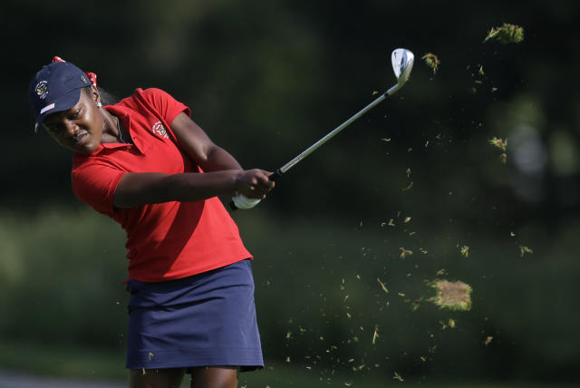 United States' Mariah Stackhouse hits her approach shot to the fifth green during the 38th Curtis Cup amateur golf match against Great Britain and Ireland Friday, June 6, 2014, in St. Louis. (AP Photo/Jeff Roberson)