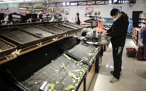 Shops have been emptied in Wuhan as people bunker down - Credit: Getty Images