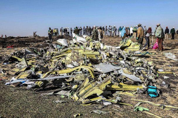 PHOTO: People stand near collected debris at the crash site of Ethiopia Airlines near Bishoftu, southeast of Addis Ababa, Ethiopia, March 11, 2019. (Michael Tewelde/AFP/Getty Images, FILE)