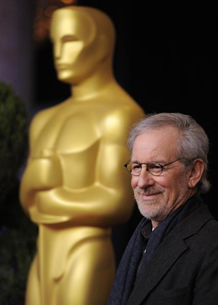 """FILE - In this Monday, Feb. 4, 2013 photo, Steven Spielberg, nominated for directing and best picture for """"Lincoln,"""" arrives at the 85th Academy Awards Nominees Luncheon at the Beverly Hilton Hotel, in Beverly Hills, Calif. """"Lincoln"""" leads the field with 12 Academy Awards nominations, including one for director Steven Spielberg. The 85th Academy Awards will be held in Los Angeles on Sunday, Feb. 24. (Photo by Chris Pizzello/Invision/AP, File)"""