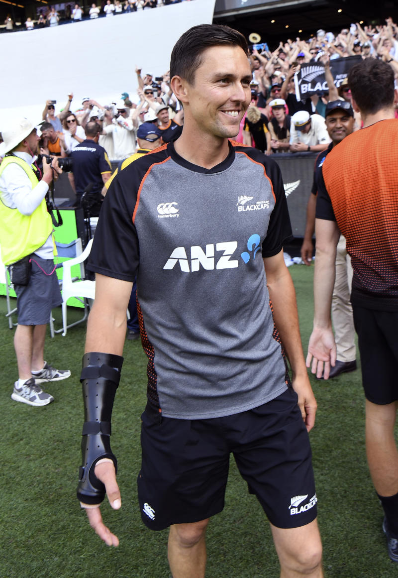 New Zealand player Trent Boult smiles after New Zealand lost to Australia.