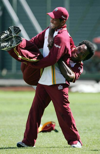 AUCKLAND, NEW ZEALAND - FEBRUARY 13: Ramnaresh Sarwan of the West Indies swings his team mate Chris Gayle during the West Indies training session at Eden Park on February 13, 2006 in Auckland, New Zealand  (Photo by Sandra Mu/Getty Images)