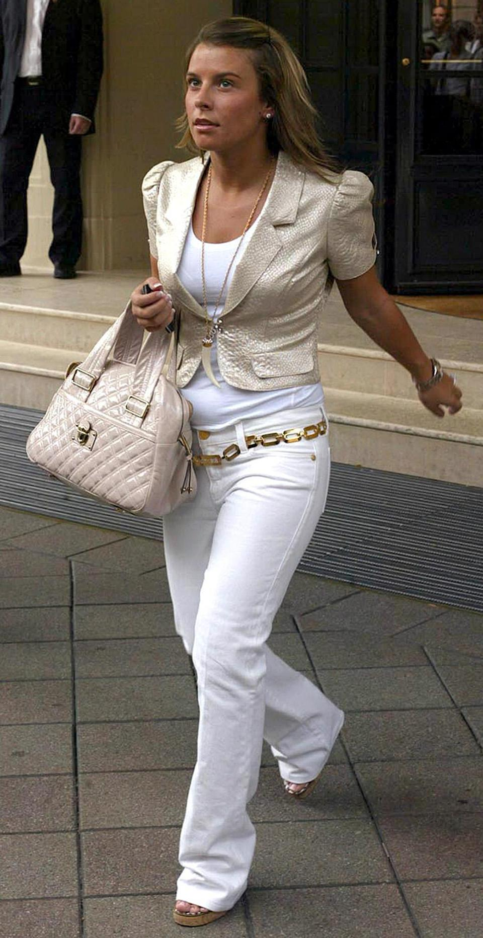 <p>Colleen McLoughlin (now known as Colleen Rooney) also joined the WAG line-up back in 2006 to show support for future husband, Wayne Rooney. And she was a girl after our own noughties heart, as she packed a plethora of white jeans and layered necklaces for the Germany trip. <em>[Photo: Rex]</em> </p>