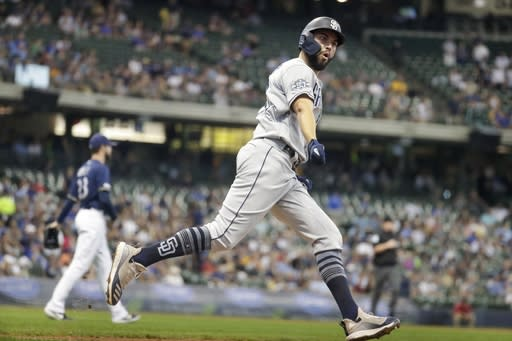 San Diego Padres' Eric Hosmer celebrates his home run during the fourth inning of a baseball game against the Milwaukee Brewers Thursday, Sept. 19, 2019, in Milwaukee. (AP Photo/Morry Gash)