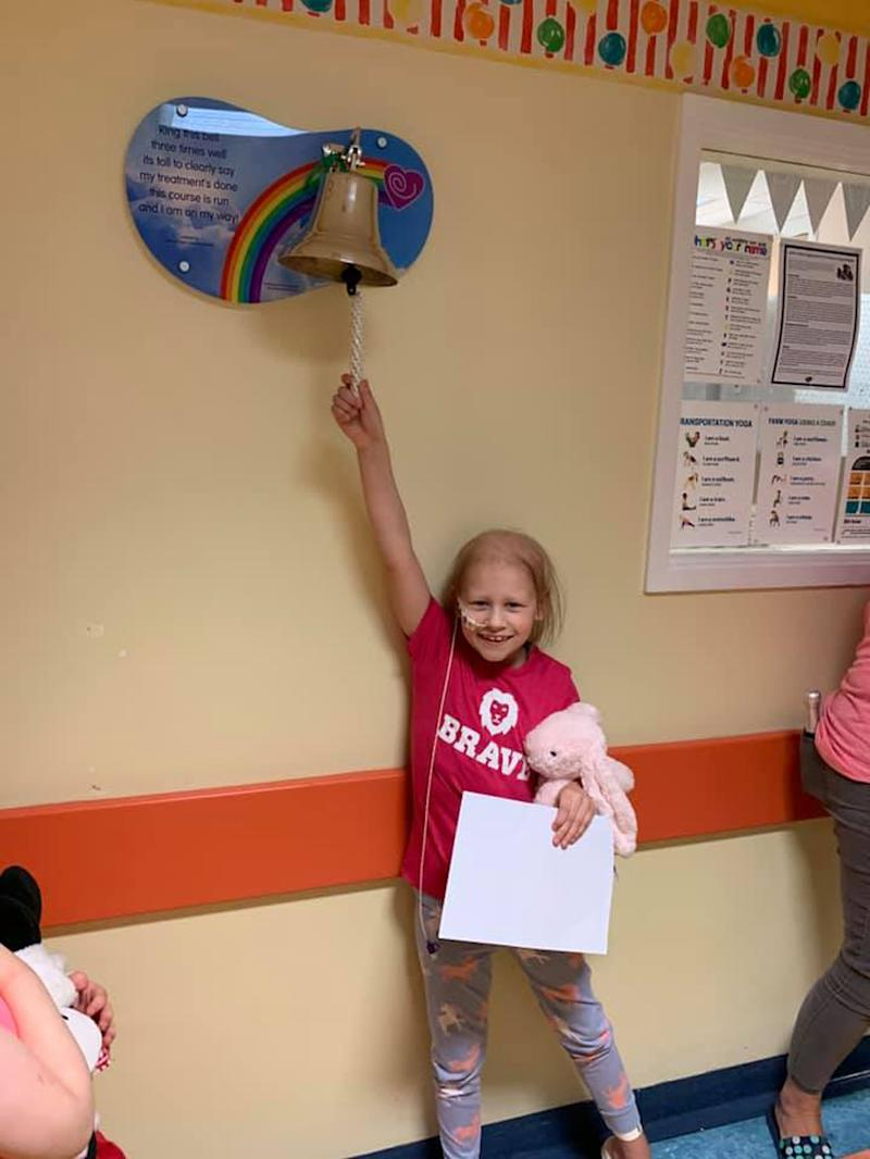 Olivia ringing the end of treatment bell. (PA Real Life)