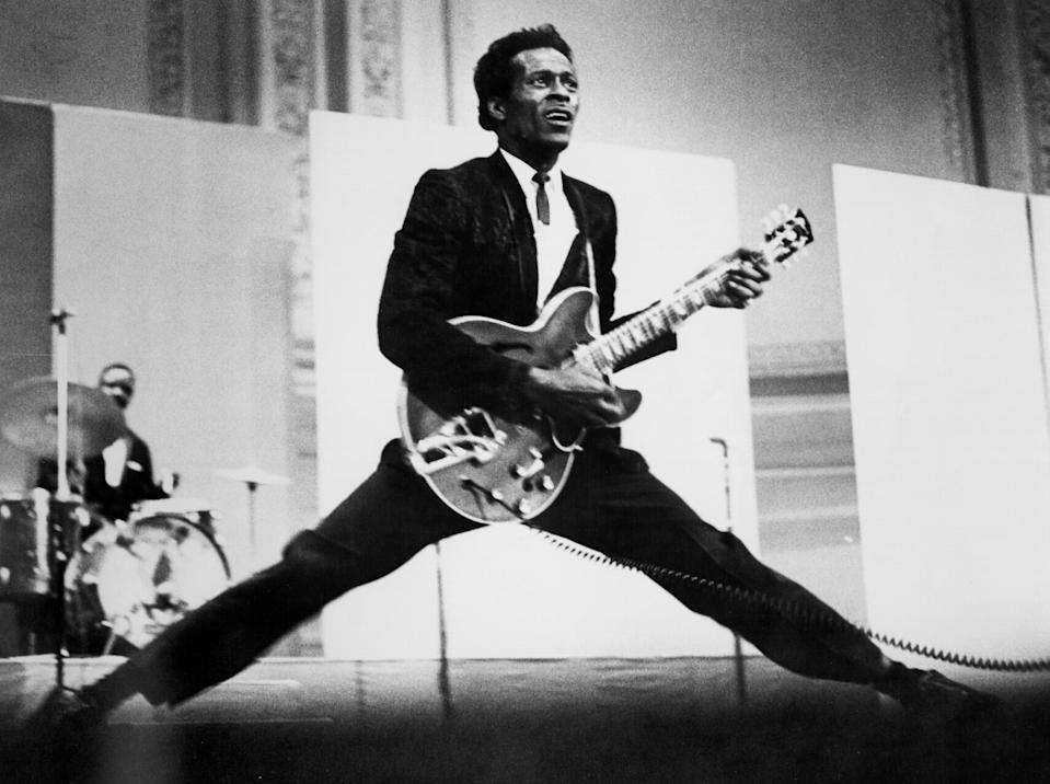 """<p>The music legend was 90 when <a rel=""""nofollow"""" href=""""https://www.yahoo.com/music/chuck-berry-laid-rest-star-140700272.html"""" data-ylk=""""slk:he died March 18;outcm:mb_qualified_link;_E:mb_qualified_link;ct:story;"""" class=""""link rapid-noclick-resp yahoo-link"""">he died March 18</a> from cardiac arrest, at his home in St. Charles County, Mo. The musician, widely credited as a pioneer of rock music, was best known for tunes such as """"Johnny B. Goode"""" and """"Maybellene,"""" influencing a wide range of artists, including Elvis Presley, the Beatles, the Rolling Stones, and the Beach Boys. Berry's funeral took place in his hometown of St. Louis at the Pageant, a club where he often performed. (Photo: Getty Images) </p>"""