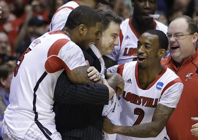 Russ Smith (2) celebrates advancing to the 2013 Final Four with his teammates and Rick Pitino. (AP)