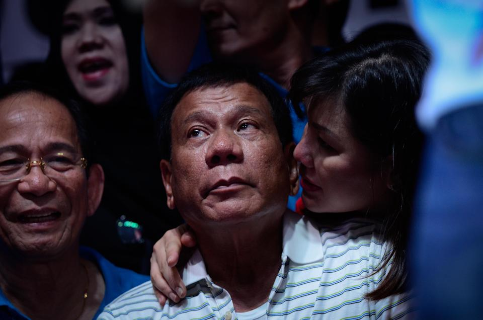 FILE PHOTO: Philippines Presidnet Rodrigo Duterte listens to political speeches during a campaign rally on April 23, 2016 in Manila, Philippines. (Photo by Dondi Tawatao/Getty Images)