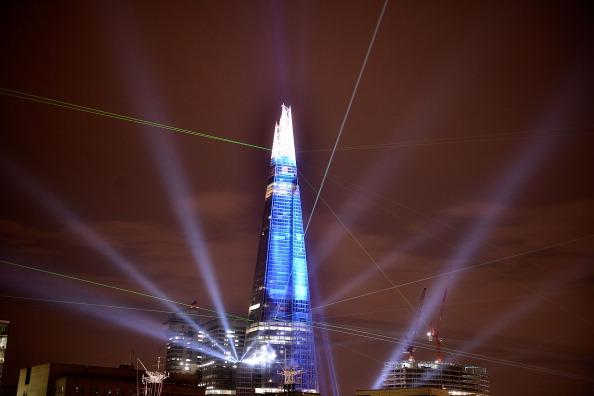 LONDON, ENGLAND - JULY 05:  The Shard is seen lit up during a laser light show from Tower Millennium Pier on July 5, 2012 in London, England.  The European Union's tallest building, designed by Italian architect Renzo Piano, stands at 310 meters tall situated on London's Southbank was formally inaugurated this evening with a laser show that was streamed live on the Internet.  (Photo by Bethany Clarke/Getty Images)