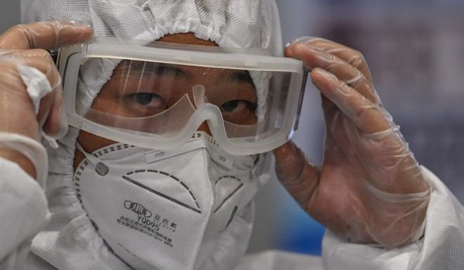 The head of China's disease control and prevention centre says people should err on the side of caution when it comes to wearing face masks. Photo: AFP