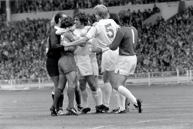 Leeds' Norman Hunter (centre) and referee Bob Matthewson restrain Liverpool's Kevin Keegan (second left) after he and Billy Bremner had clashed