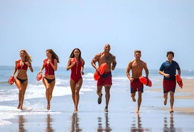 <em>Baywatch</em> cast Kelly Rohrbach, Alexandra Daddario, Ilfenesh Hadera, Dwayne Johnson, Zac Efron, and Jon Bass. (Photo: Frank Masi/ © Paramount Pictures /courtesy Everett Collection)