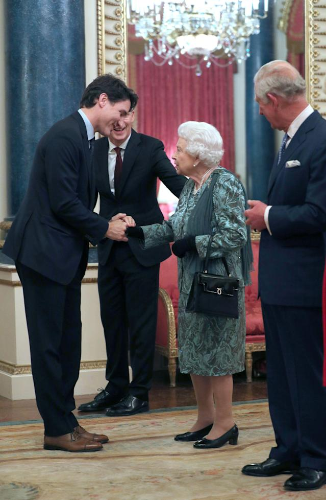The Queen welcomes Justin Trudeau at Buckingham Palace during the NATO summit. (Getty Images)