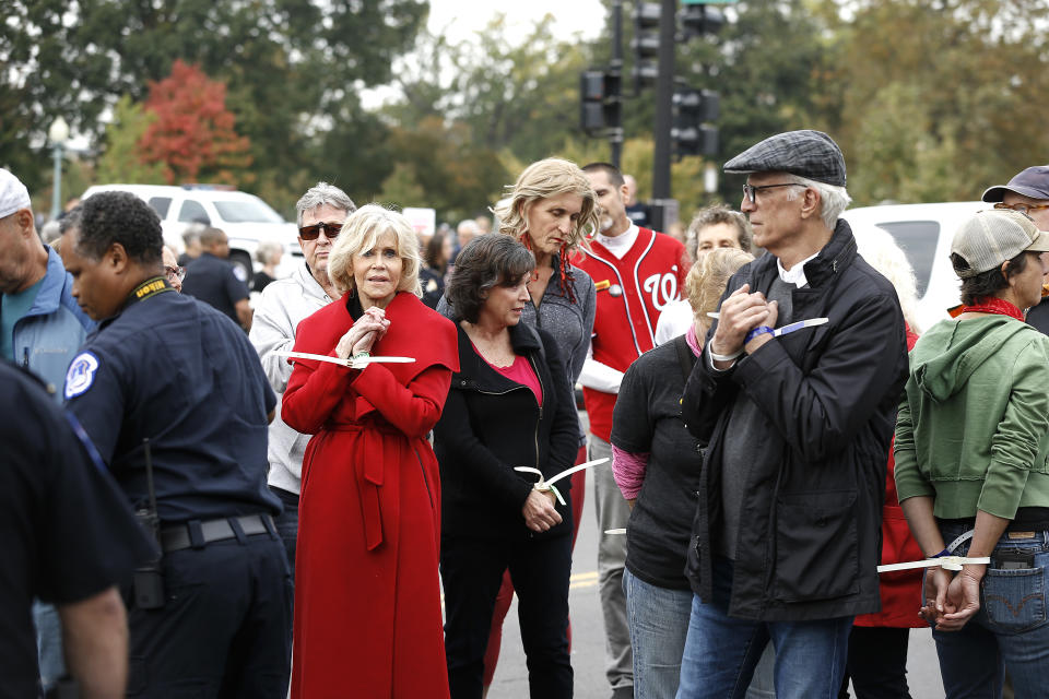 "WASHINGTON, DC - OCTOBER 25: Actors Jane Fonda and Ted Danson are arrested during the ""Fire Drill Friday"" Climate Change Protest on October 25, 2019 in Washington, DC . Protesters demand Immediate Action for a Green New Deal. Clean renewable energy by 2030, and no new exploration or drilling for Fossil Fuels.  (Photo by John Lamparski/Getty Images)"