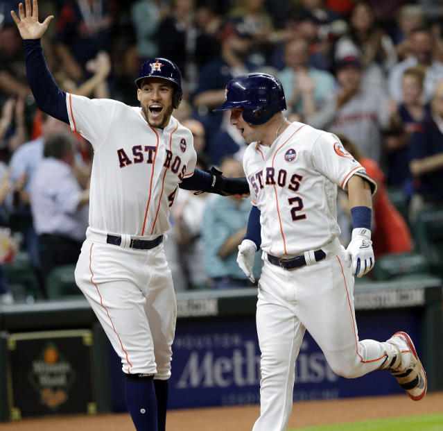 Houston Astros' George Springer (4) and Alex Bregman (4) celebrate at the plate after they both scored on a two-run home run by Bregman against the Minnesota Twins during the third inning of a baseball game Wednesday Sept. 5, 2018, in Houston. (AP Photo/Michael Wyke)