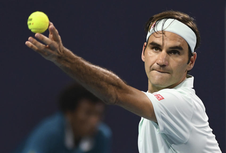 Roger Federer, of Switzerland, serves to Denis Shapovalov, of Canada, during the semifinals of the Miami Open tennis tournament, Friday, March 29, 2019, in Miami Gardens, Fla. (AP Photo/Jim Rassol)