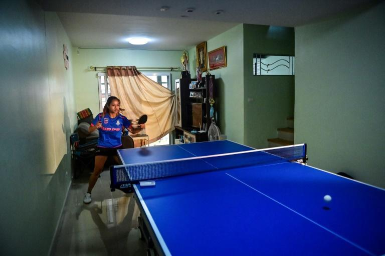 """Training room: Thai table tennis player Orawan """"Thip"""" Paranang practises in her living room at home for the Tokyo Olympics"""