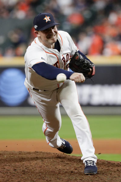 Houston Astros relief pitcher Joe Smith throws against the New York Yankees during the 11th inning in Game 2 of baseball's American League Championship Series Sunday, Oct. 13, 2019, in Houston. (AP Photo/Eric Gay)