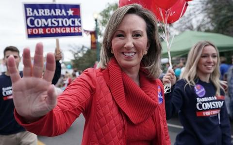 Republican Barbara Comstock waves to constituents during the annual Haymarket Day parade in Haymarket, Virginia - Credit: Alex Wong/Getty