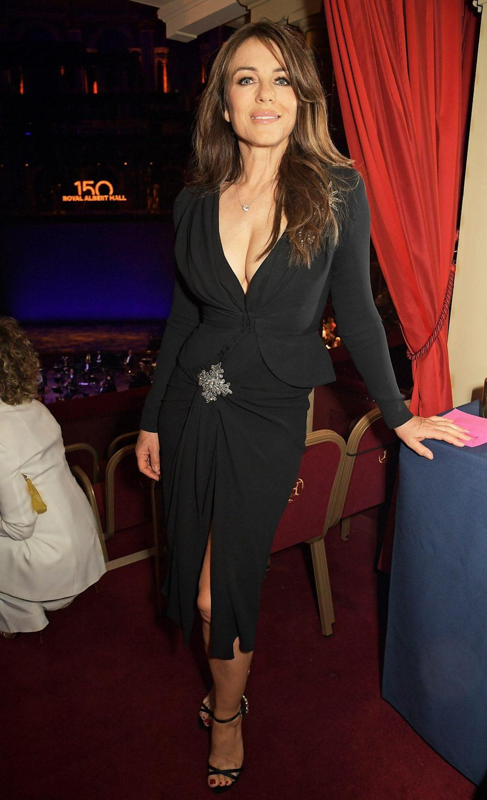 """<p>Elizabeth Hurley (<a href=""""https://people.com/movies/elizabeth-hurley-says-shes-still-friends-with-hugh-grant/"""" rel=""""nofollow noopener"""" target=""""_blank"""" data-ylk=""""slk:who recently spoke to us for our PEOPLE in the '90s podcast"""" class=""""link rapid-noclick-resp"""">who recently spoke to us for our PEOPLE in the '90s podcast</a>!) turns heads as she arrives at the inaugural British Ballet Charity Gala, presented by Dame Darcey Bussell, at The Royal Albert Hall in London on June 3. </p>"""