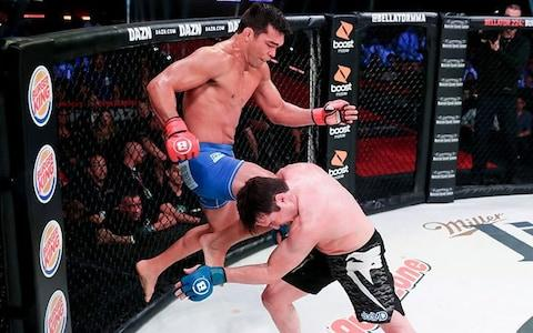 Lyoto Machida drops Chael Sonnen with a flying knee at Madison Square Garden - Credit: Lucas Noonan/Bellator