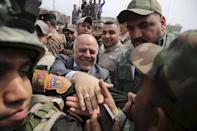 Iraq's Prime Minister Haider al-Abadi (C) tours the city of Tikrit after Iraq security forces regained control from Islamist State militants in this April 1, 2015 file photo. REUTERS/Stringer/Files