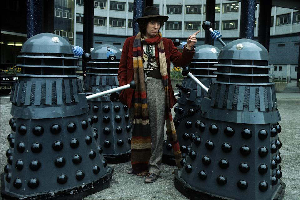 LONDON, ENGLAND - JANUARY 01:   English actor Tom Baker in his role as the fourth incarnation of Doctor Who in the British science fiction television series of the same name. With him are two of his arch-enemies the Daleks in 1975 in London, England. (Photo by Anwar Hussein/Getty Images)